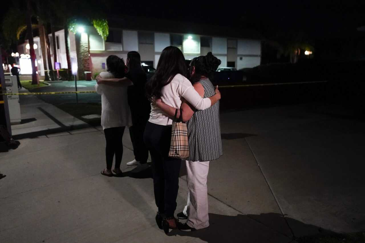 mass-shooting-people-comfort-each-other